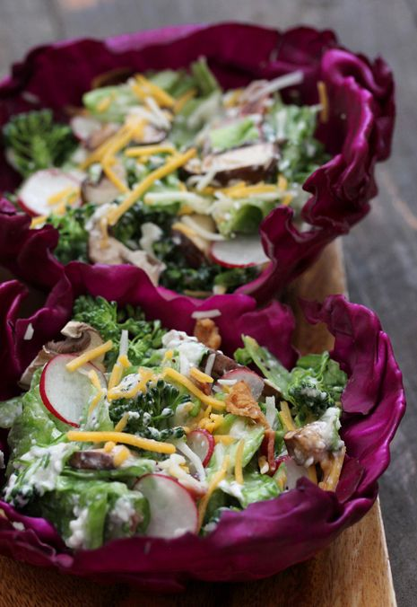 Wilted Salad -  Don't be fooled by it's simple appearance. This salad is delicious!  Add grilled chicken for a hearty meal. Colorful presentation in the purple cabbage bowls.