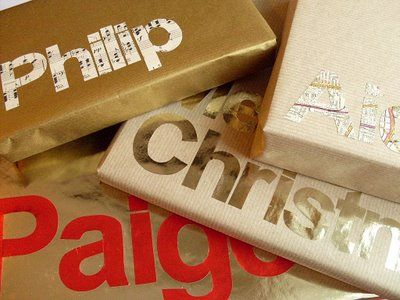 Gift wrap idea: cut letters out of contrasting paper. From Bugs & Fishes blog.