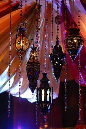 The hanging lamps with beaded cords is an awesome look, though I wouldn't use fire and I would want to rig it to all light up at once.