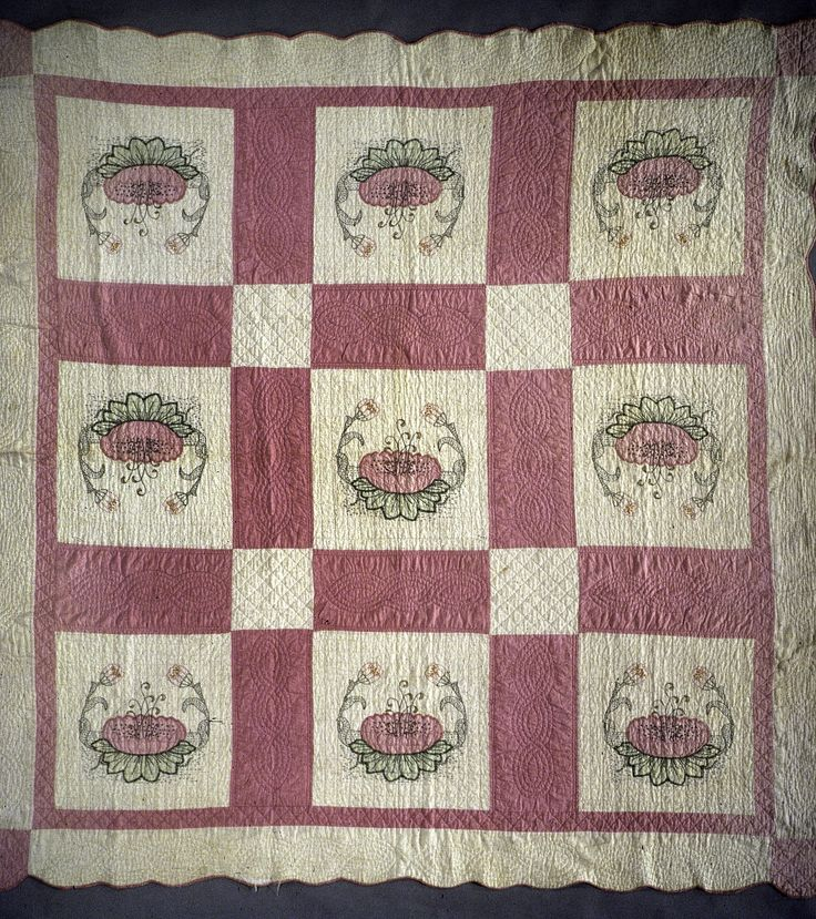 """Olive Bender made this quilt for her son and daughter-in-law as a Christmas gift in the 1940s. Popular in the 1920s to 1940s, the """"Water Lily"""" motif was available in kit form or as a paper pattern. Quilt historian, Cuesta Benberry, traced this pattern to the Rainbow Quilt Block Company owned by William Pinch."""
