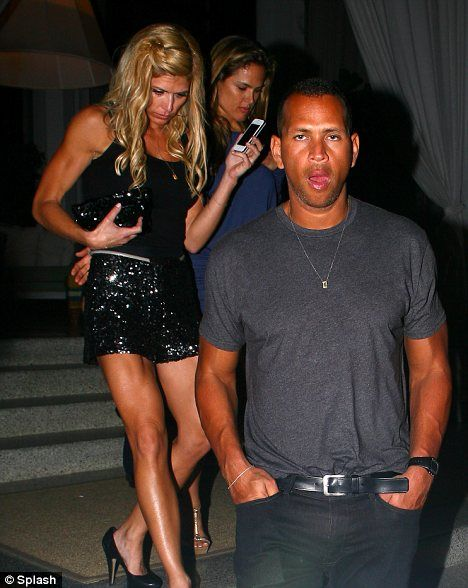 She's got the brawn: Torrie Wilson appeared to have more muscles than her boyfriend Alex Rodriguez
