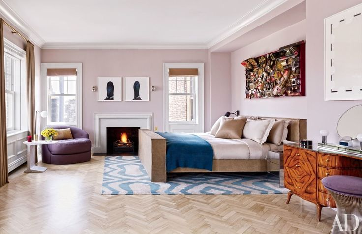 In this Manhattan penthouse designed by Rafael de Cárdenas, an artwork by Rammellzee hangs over the master suite's bed, which is dressed with a cashmere blanket by the Elder Statesman | archdigest.com