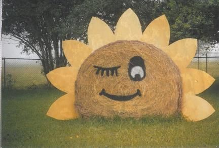 Family enjoyed decorating round hay bales