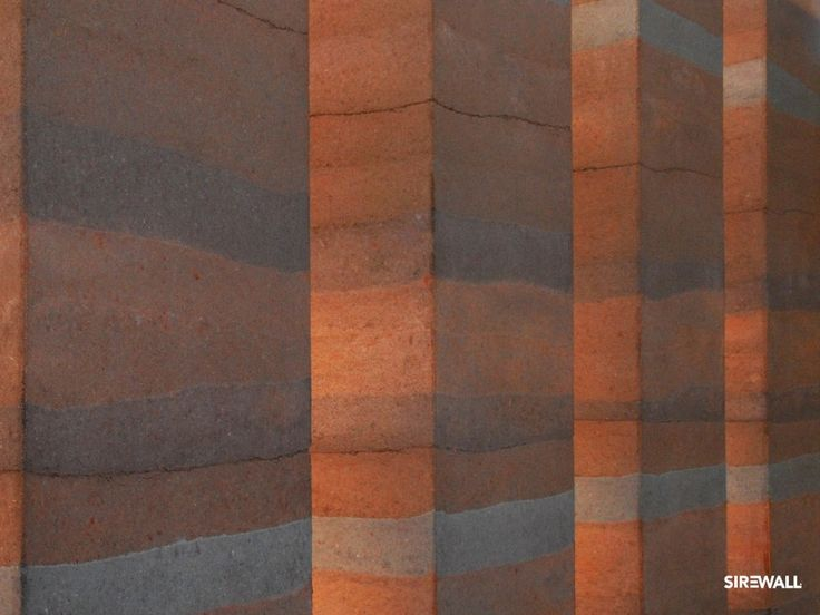 Texture Maps for Architects/Designers – SIREWALL | Structural Insulated Rammed Earth. Collonade in lifts of rusty reds, deep orange and dark grey.