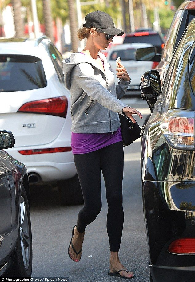 Lean and slender: The 35-year-old dressed her perfectly toned curves in black gym leggings...