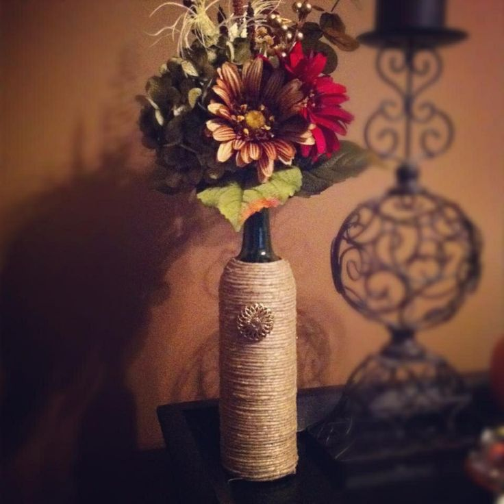 Wine bottle centerpieces weddings pinterest bottle for Wine bottle wedding centerpieces
