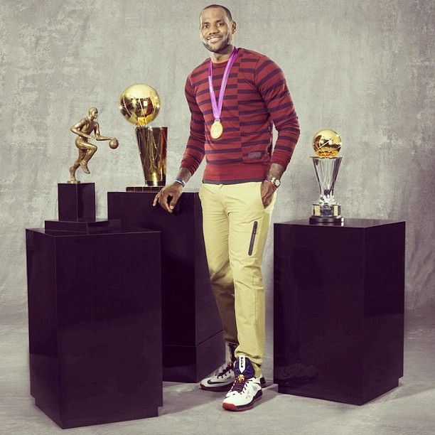 LeBron James with the 2012 NBA Most Valuable Player Award, the 2012 NBA Finals Most Valuable Player Award, the 2012 NBA Championship trophy, and his 2012 Summer Olympic gold medal.