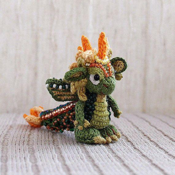 Green dragon fantasy dragon. knitted crocheted dragon mascot