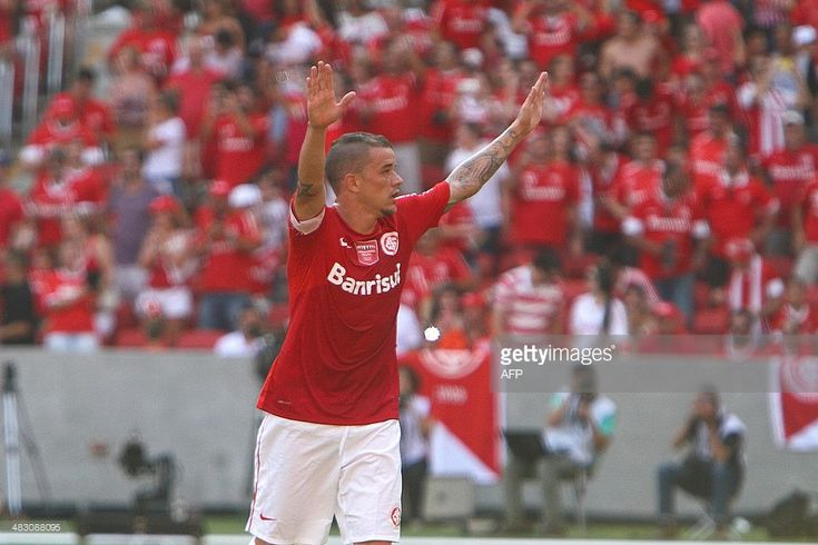 Argentine footballer Andres D'Alessandro, player of Brazilian team Internacional, celebrates after scoring during the friendly match against Uruguay's Penarol to inaugurate the Beira Rio Stadium, in Porto Alegre, Rio Grande do Sul, in southern Brazil, on April 6, 2014. The Beira Rio will host five matches of the upcoming FIFA World Cup Brazil 2014. AFP PHOTO / Lucas UEBEL