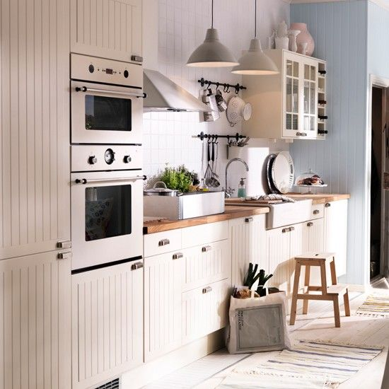 This pretty country-style kitchen from Ikea looks deceptively expensive. The tongue and groove doors give the units a Shaker-style charm and, when combined with the chunky wooden worktop and ceramic butler sink, create the impression of a bespoke country kitchen at a fraction of the price