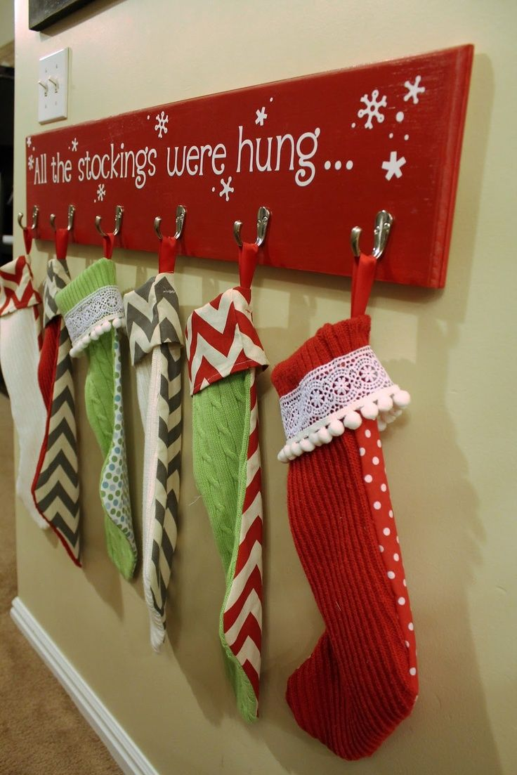 #Stocking hanging board for #Christmas. There's no fireplace in our new house. I wonder if you could put it in a spot where it could be used for sweaters or some other kind of hanging during the year. (Or maybe a curtain rod hung somehow instead of hooks? Then you could add more stockings without much trouble in case of company or more kids. Gotta figure it out by next year.)