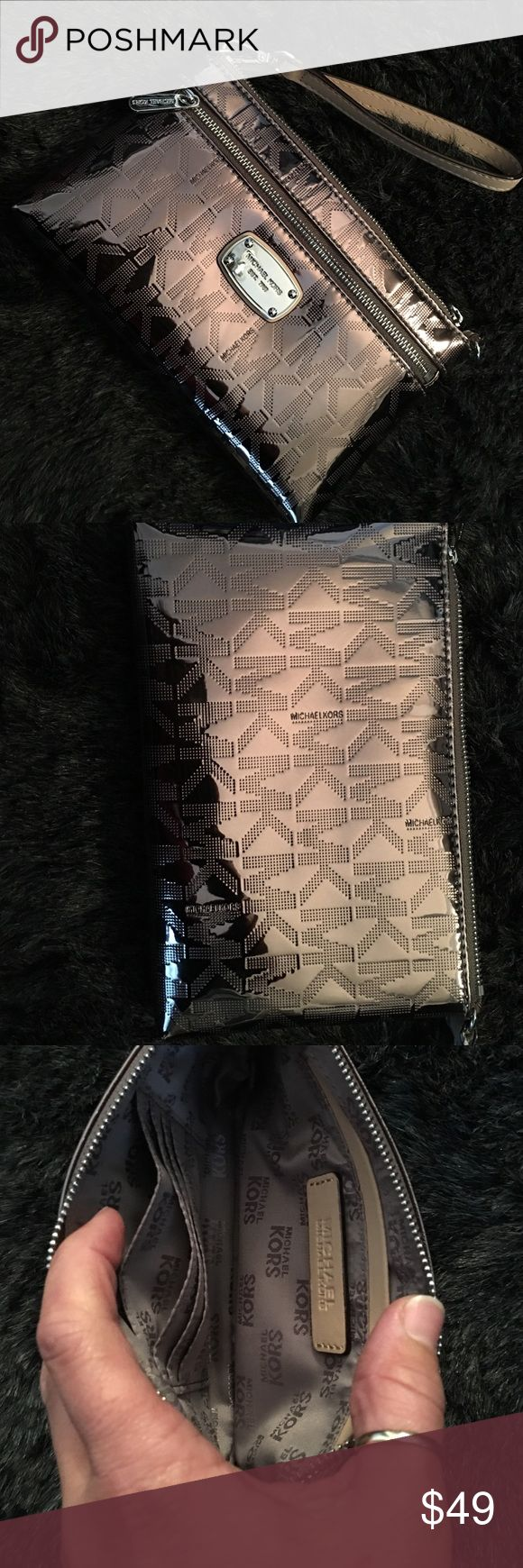Michael Kors purse Brand new, never used!  Pewter color. Michael Kors Bags Clutches & Wristlets