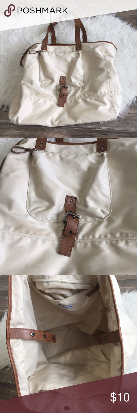 Cream Tote Bag Cream Tote Bag with Carmel brown accents - from bath and body works - gently used- has some light signs of wear but still lots of life left -works great as a purse, storage bag, grocery bag, etc- gently used condition Bags Totes