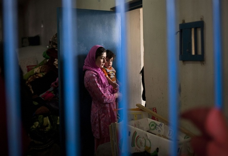 """Anja Niedringhaus / APPrisoners in their cell at Badam Bagh, Afghanistan's central women's prison, in Kabul. A total of 202 women are imprisoned in the six-year-old jail, the majority of them in connection to so-called """"moral"""" crimes."""