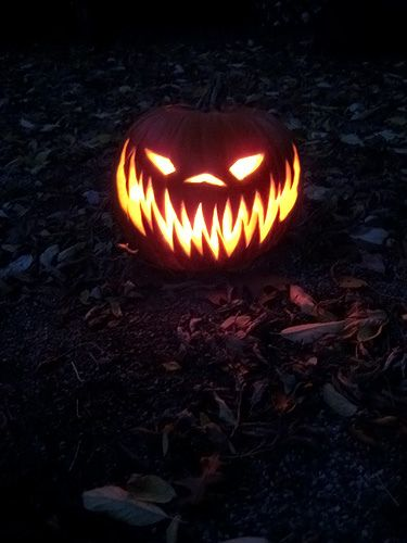 creepy carved pumpkin