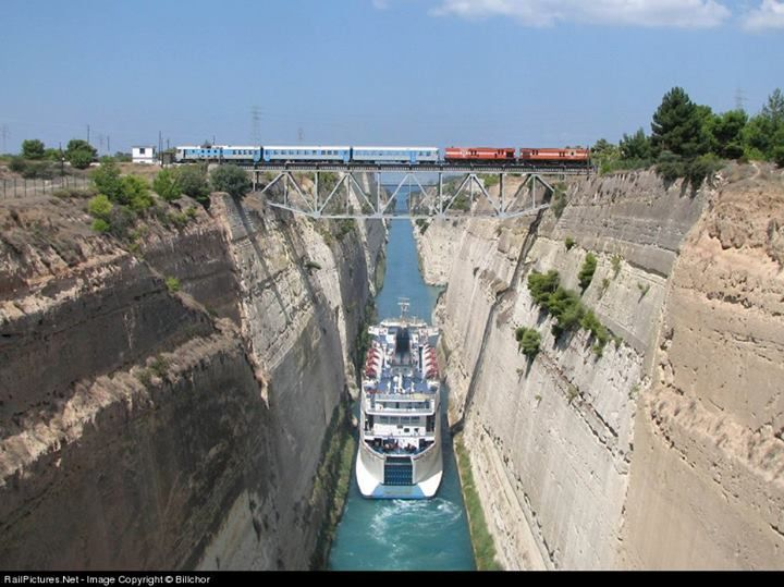 Corinth Canal - The canal consists of one channel 26 ft deep measuring 4 miles long by 81 ft wide at the top and 70 ft wide at the bottom. The rock walls, which rise 300 ft above sea level, are at a near-vertical 80° angle. The canal is crossed by a railway line, a road and a motorway at a height of about 148 ft. It can only accommodate ships of a width of up to 54 ft and a draft of 24 ft. Ships can only pass through the canal one at a time. 11,000 ships per year travel through the canal.