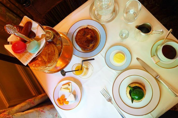 """Brunch feast @maisonladuree on Champs Elysées. . Warm french toast with maple syrup. Egg in a asparagus tart. Mini viennoiseries with butter honey & jam. Cheese selection. Macarons. Milk & dark chocolate """"langues de chat"""" biscuits. Granola fresh fruit salad & yoghurt. Plus fresh orange juice & coffee. . Heavenly activity for a Saturday! . #champselysees #foodie #brunch #yum #eattheworld #macarons #paris #frenchfood #happy #wheninparis #weekend #ilovemylife"""
