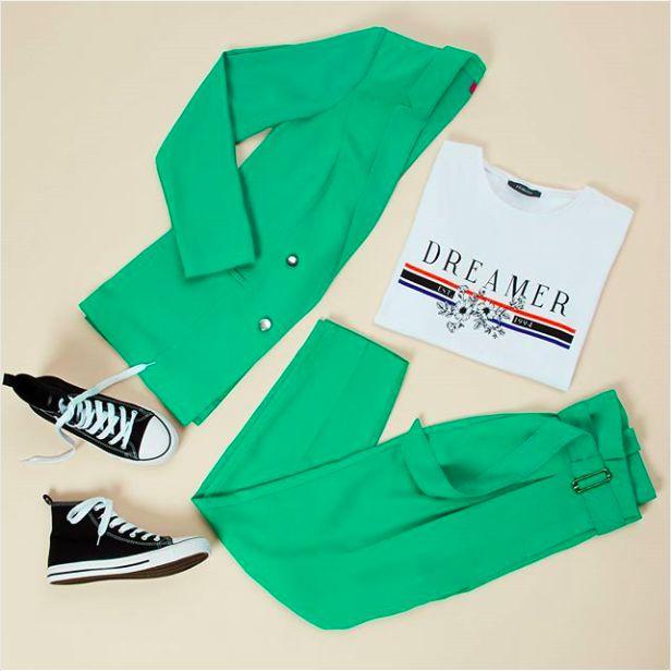 Primark green trousers suit, dreamer' slogan tee, trainers