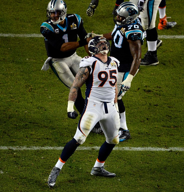 . Cam Newton (1) of the Carolina Panthers is helped up by teammate Trai Turner (70) of the Carolina Panthers as Derek Wolfe (95) of the Denver Broncos celebrates sacking him in the third quarter.  The Denver Broncos played the Carolina Panthers in Super Bowl 50 at Levi\'s Stadium in Santa Clara, Calif. on February 7, 2016. (Photo by Helen H. Richardson/The Denver Post)