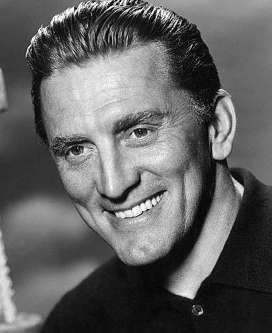 kirk douglas - (December 9, 1916) is an American actor, producer, director, and author. He is one of the last living people of the film industry's Golden Age. After an impoverished childhood with immigrant parents and six sisters, he had his film debut in The Strange Love of Martha Ivers (1946)