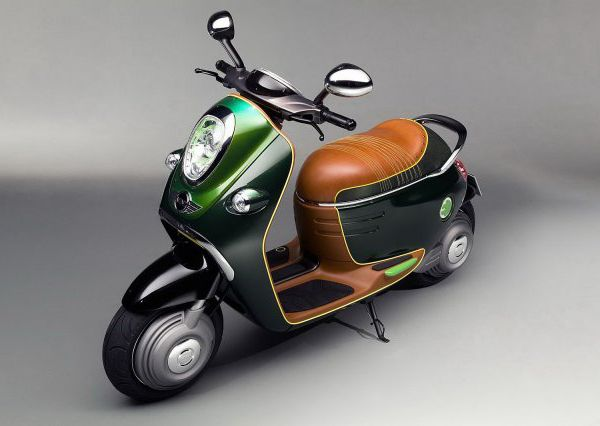 This concept shares traditional MINI design: these are typical large speedometers and oval mirrors, square rear lights and chrome inserts.#scooter #mini #design