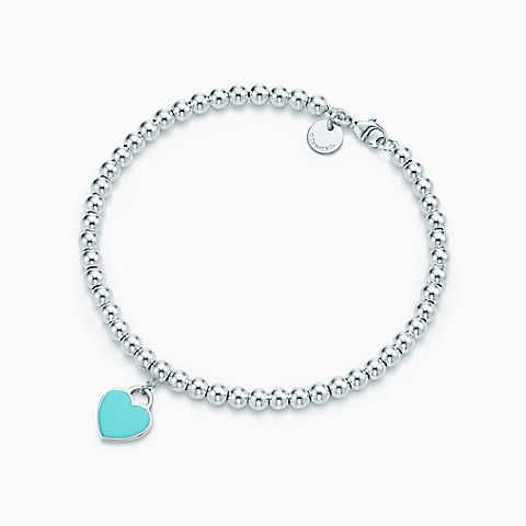 Return to Tiffany® mini heart tag in sterling silver on a bead bracelet.