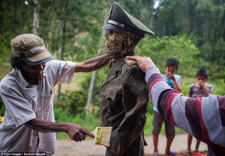 The body of L Sarungu, an army veteran dead for 10 years, is carefully cleaned and groomed during the Ma'nene ritual at Panggala Village