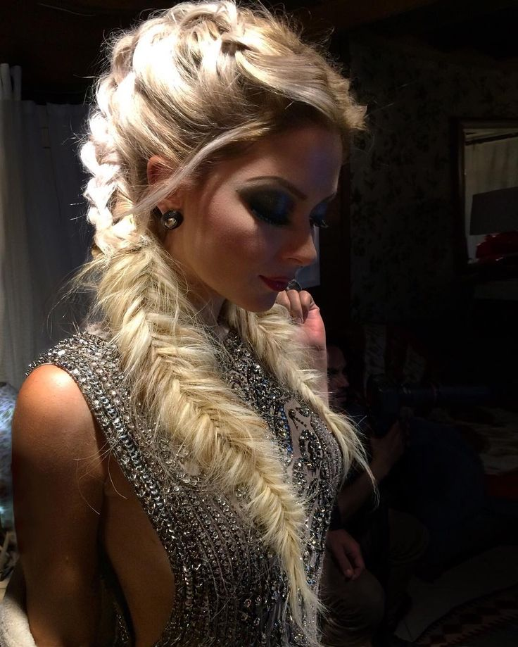 Messy fishtail braid and dramatic makeup