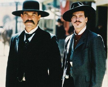 Kurt Russell as Wyatt Earp and Val Kilmer as Doc Holliday (Tombstone)