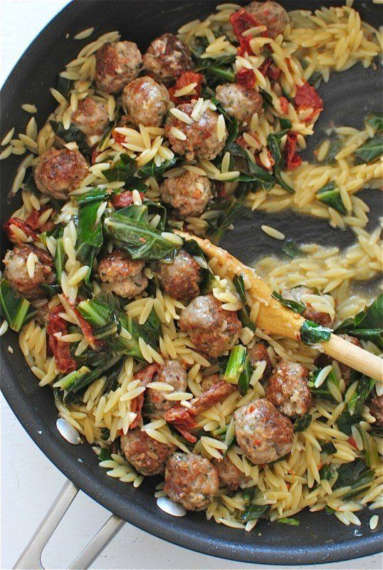 This simple riff on a the classic spaghetti and meatballs is an easy meal you can make on any given weeknight. There's a ton of flavor in the sausage meatballs, great texture with the orzo and sundried tomatoes, and some hearty greens to bind the whole thing together.