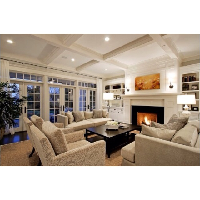 Paul Moon Design Gorgeous Living Room With Coffered Ceiling Wall Of French Doors And Transom Windows Fireplace White Built Ins
