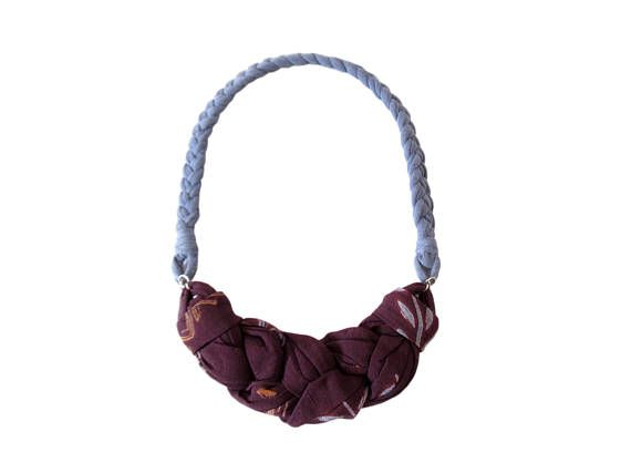 Handmade braided necklace to wear with any outfit! This fabric necklace is made of a violet blue cotton braid combined with a purple viscose fabric and silver rings.