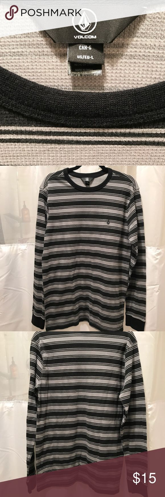 Men's Volcom long-sleeved top. Size Large. NWOT Volcom men's long sleeve top. Size large. Background is gray. Alternating pattern consists of wide and thin horizontal black stripes. Volcom Shirts Tees - Long Sleeve