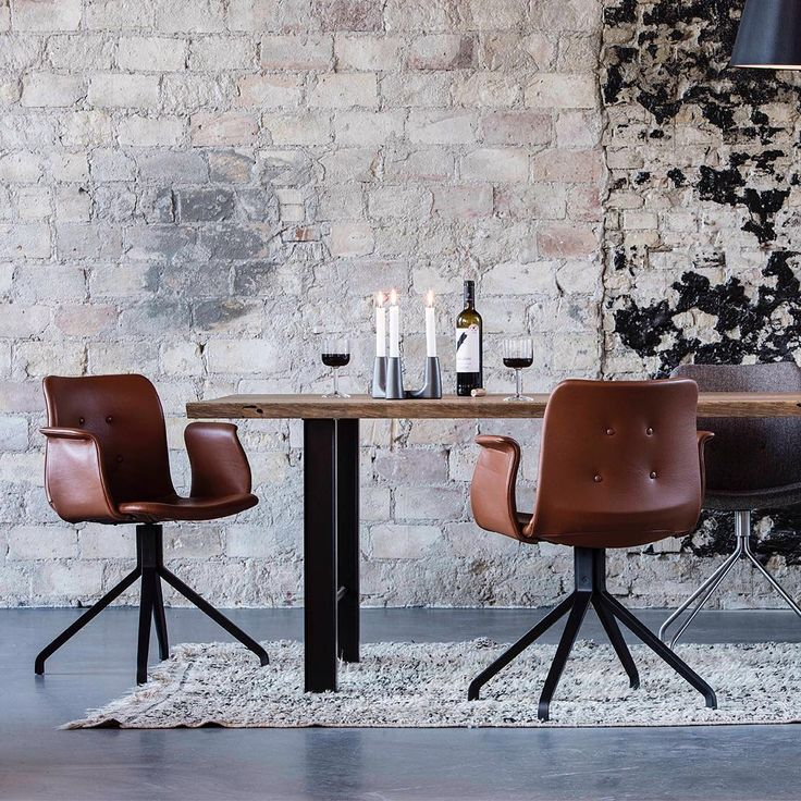 Primum Dining Chairs and dining table Track by Bent Hansen.