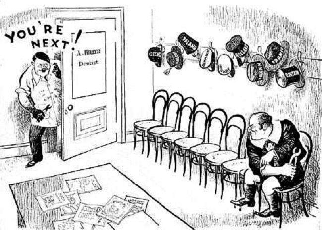 """""""Você é o próximo!"""" diz Hitler à Churchill, o Primeiro-Ministro da Inglaterra. Pendurados acima da Inglaterra, encontram-se chapéus e cartolas de países já vencidos pela Alemanha nazista. Imagem: autor desconhecido."""