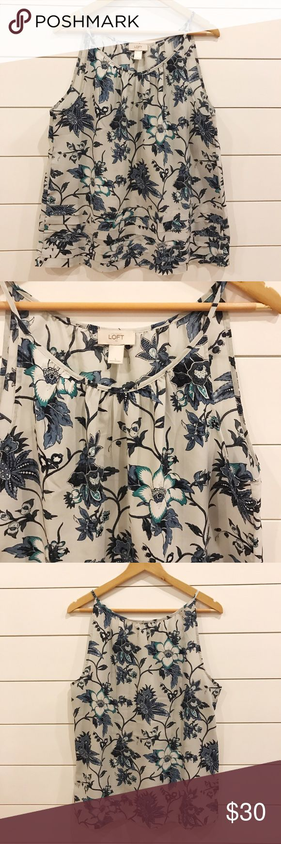 Strappy Cami Top This top can be worn on the weekends with denim shorts or to the office under a blazer or cardi! Spaghetti straps and slight racerback. Worn only a handful of times; in excellent condition. 100% Polyester. Machine wash cold. Tumble dry low. LOFT Tops