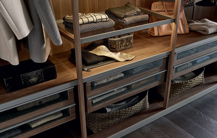 Shelves in walnut c. melamine with piombo painted aluminium frame. Chest of drawers with piombo painted Track handles, transparent glass front, drawers bottom in 01 visone techno-leather.