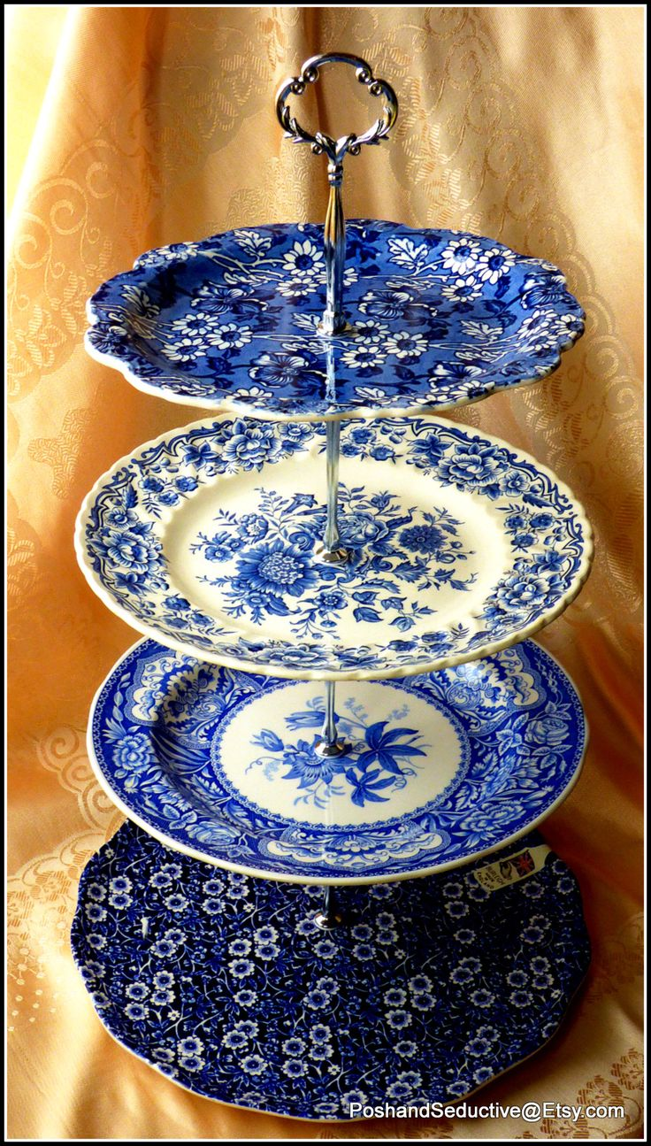 "Signature bespoke handmade tiered cake stand featuring best samples of English made branded blue and white transferware large cake and dinner plates by Burleigh ""Blue Calico"", Spode ""Blue Room Collection"" floral pattern and Ridgway ""Clifton"" floral pattern made in Staffordshire makes this creation outstanding and supports Best of British Old Victorian afternoon tea tradition. Thumbs up!!! #Staffordshirechina #cakestand #blueandwhitechina #Cambridge #BestofBritish"