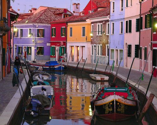 Burano, Italy.  Originally the houses were painted bright colors so the fisherman could find their way home.