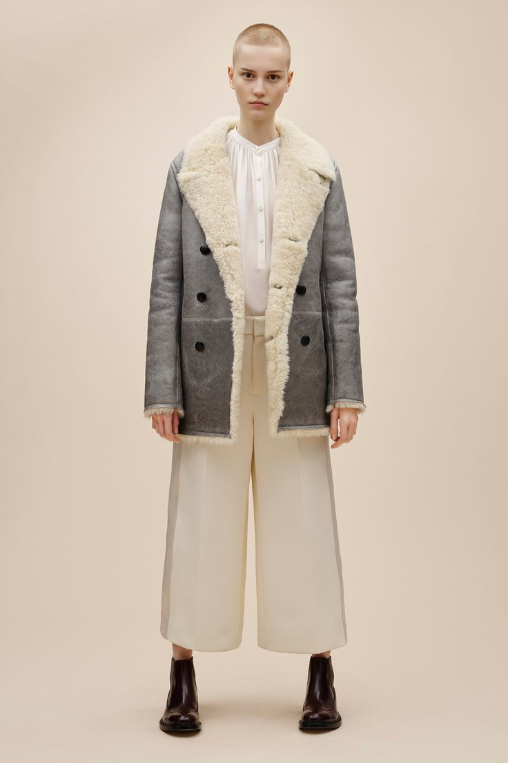 Creative director Louise Trotter, the woman responsible for injecting a heavy dose of coolness to Joseph's storied sophistication, has killed it once again with the British label's pre-fall collection. Menswear inspired silhouettes, like slouchy cardigans and baggy trousers, are married so