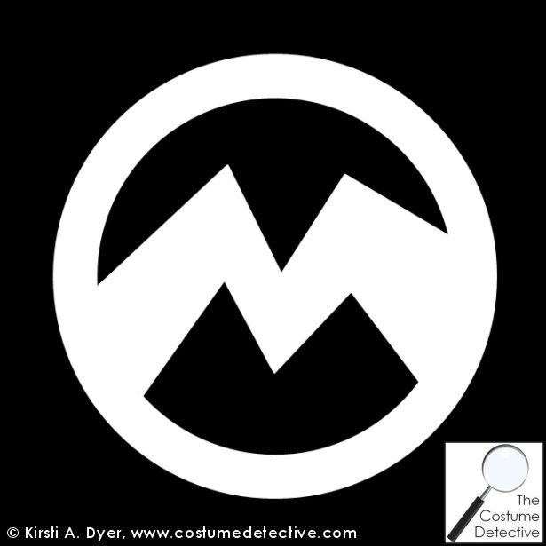 """Evil Minion – El Macho Logo.  The evil minions wear a stylized """"M"""" for El Macho. Download the free template and print out the """"M"""" logo into paper or fabric. Then add it to the front of your Evil Minion Costume."""