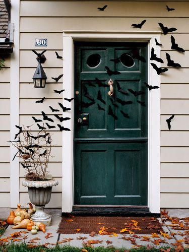 Felt bats. I'd thing you need to wire them somehow as well, but they're cute! Outdoor Halloween Decorations - Halloween Outdoor Decor - Country Living