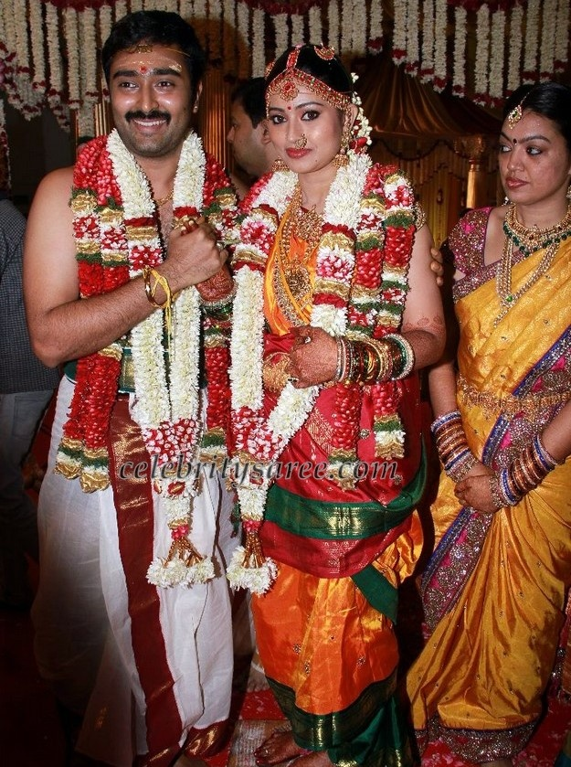 South Indian bride and groom with a close relative.