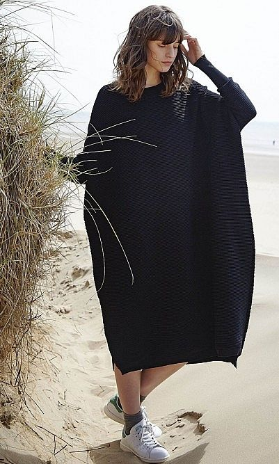 Oversized pleasingly weighty horizontal rib-knit sweater dress.