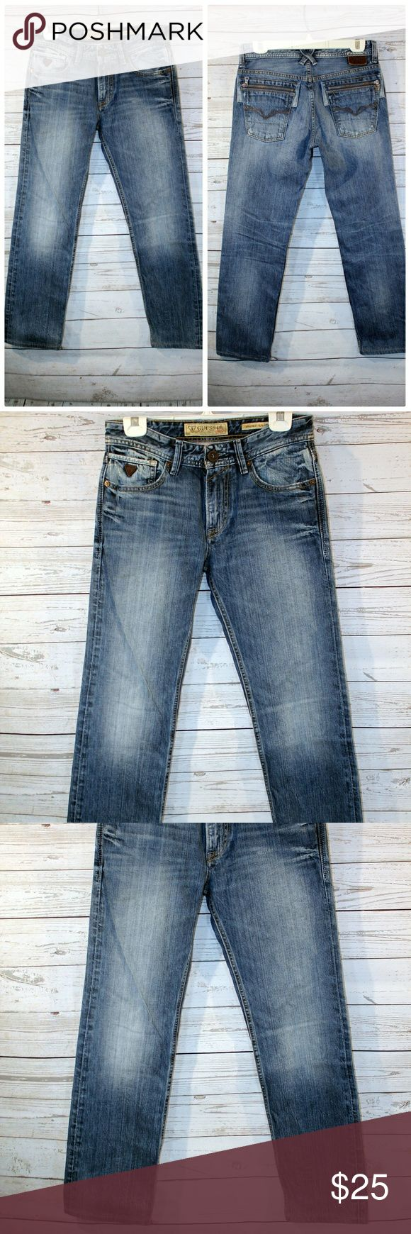 """Guess Jeans Mens Size 29x28 Guess Jeans Mens Size 29x28 Lincoln Slim Straight Distressed Blue Denim   All measurements are approximate and taken unstretched and laying flat.   Waist: 30"""" Length: 37.5"""" Inseam: 28"""" Rise: 9""""  GUC-  light stain on the upper leg, length has been altered to 28"""" inseam, please see photos. Guess Jeans Slim Straight"""