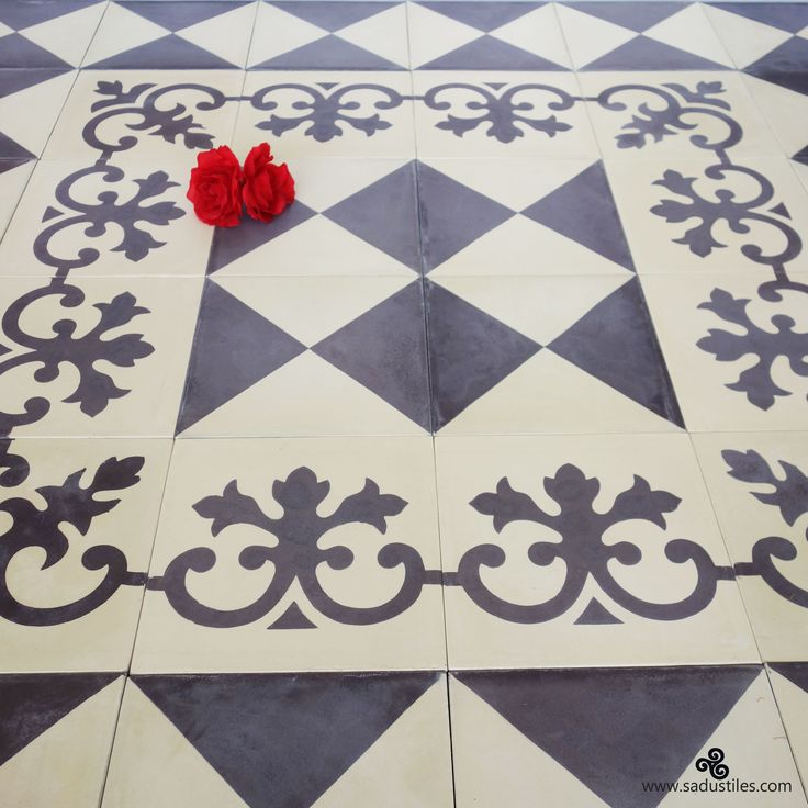 Combination border tiles and carpet tile in dark blue and living white from Sadus Tiles.