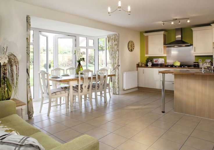 David Wilson Homes - Cornell at Nursery Gardens, Bosworth Road, Measham. Fabulous kitchen/dining room with room for a sofa, in the french country style kitchen.