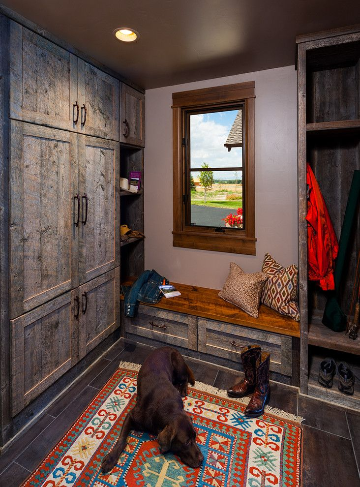 Rustic hall entry contemporary with coat closet built-in bench rustic wood cabinets colorful patterned rug