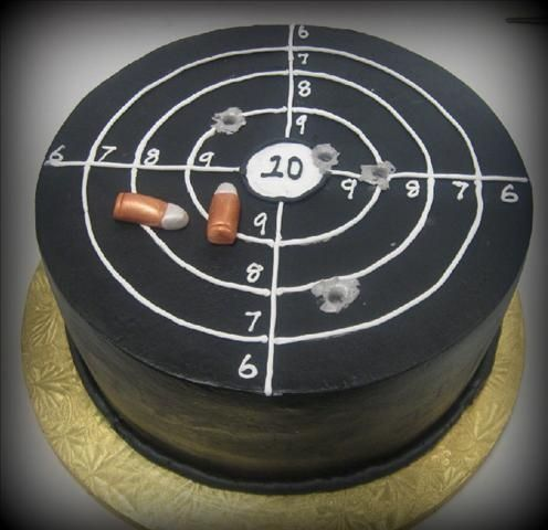 "10"" Butter Cream cake airbrushed black.  Bullets are fondant.  Bullet holes were done by sticking a dowel rod in the cake to make the h..."