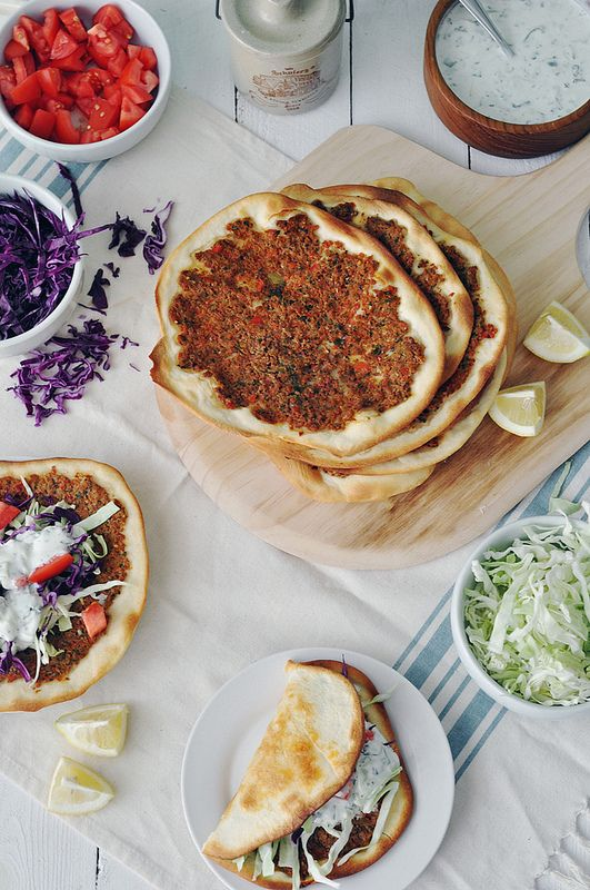 Lahmacun (Turkish Pizza) 16x Ingredients: For the dough: 5 c flour 1½ c milk, warmed ¼ c vegetable oil 3 teaspoons (18 grams) salt 1 teaspoon (4 grams) sugar 1 packet (2¼ teaspoons) (8 grams) active dry yeast For the filling/topping: 1 pound ground beef 3 roma tomatoes 1 red bell pepper 1 green bell pepper 1 medium yellow onion 3 garlic 2 tbs tomato paste 1 tsp red pepper flake 1 tsp cumin 1 tsp salt 1 tsp pepper 1 tsp paprika parsley mint 1 lemon 2 tbs olive oil tomatoes purple cabbage…